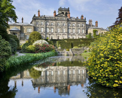The pool and Rhododendron ground with the house (not owned by the NT) beyond at Biddulph Grange Garden, Staffordshire