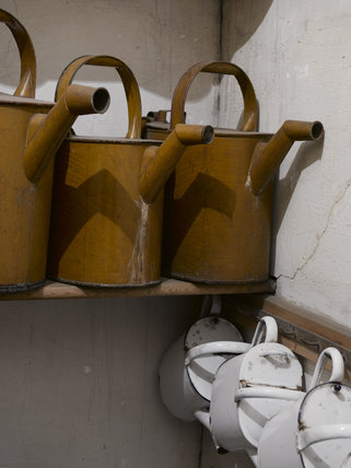 Kettles for hot water in a store room at Hardwick Hall, Derbyshire