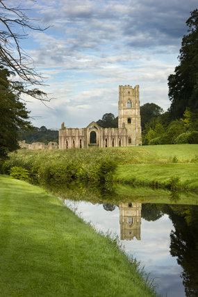 A view along the River Skell towards Fountains Abbey, North Yorkshire, a Cistercian community of monks from the twelfth century until the Dissolution in 1539