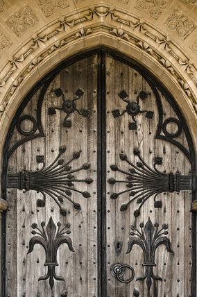 Decorative ironwork on the wooden door of St Mary's Church, a Victorian creation by William Burges built in 1871 - 8, at Studley Royal Water Garden, North Yorkshire