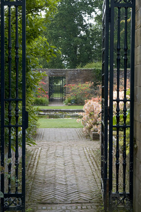 The entrance gate leading to the Lily Garden at Barrington Court, Somerset