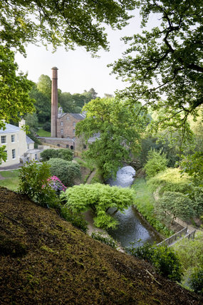 View from the top path over the garden which was created in the late eighteenth century by Samuel Greg, the mill owner, and his wife Hannah, to complement their house