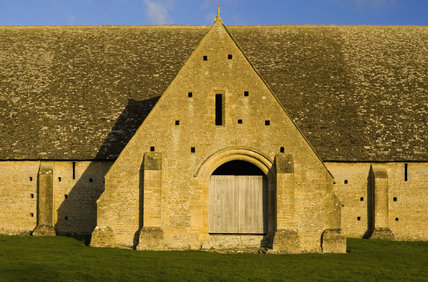 One of the projecting porches of the mid-thirteenth century monastic Great Coxwell Barn near Faringdon in Oxfordshire