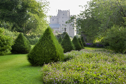 A view of the solar tower from the south west, across the yew topiary in the  Dutch Garden, at Sizergh Castle, near Kendal, Cumbria