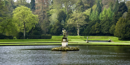 The statue of Neptune in the Moon Pond at Studley Royal Water Garden, North Yorkshire