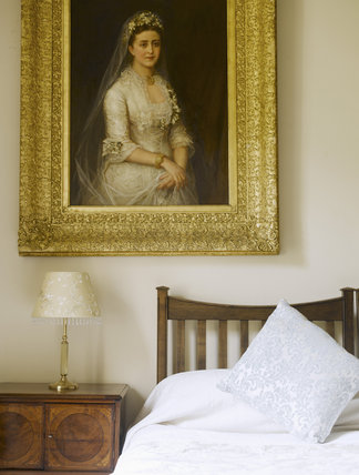 Portrait above the bed in one of the bedrooms in The Apartment at Greenway, Devon, which was the holiday home of the crime writer Agatha Christie between 1938 and 1976