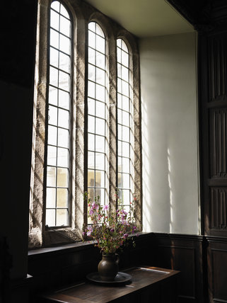 Tall stone-mullioned window in the Dining Room at Godolphin, near Helston, Cornwall