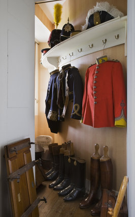 Uniforms and hunting clothes belonging to members of the Cawley family, especially Major Stephen Cawley, 20th Hussars, in the White Dressing Room at Berrington Hall, Herefordshire