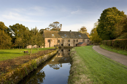 Autumn view of Fountains Mill, the oldest building on the Fountains Abbey estate in North Yorkshire