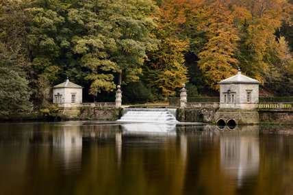 View of The Cascade (first started 1716-1730) into the Lake, showing rusticated columns and pavilions on the dam, in the garden at Studley Royal, North Yorkshire