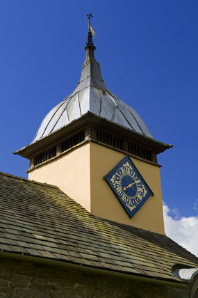 Close view of the leaded ogee cupola with a weathervane atop the bell turret and clock of the Church of St Michael, built in the fourteenth and fifteenth centuries of rough local stone, at Croft Castle, Herefordshire