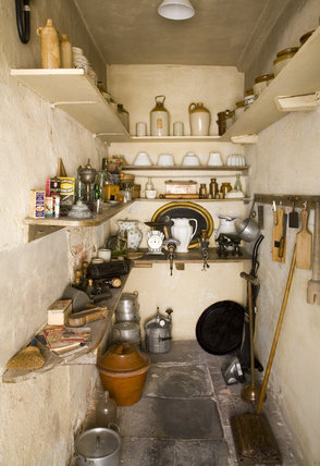 The Pantry with stone-flagged floor and household equipment, at Baddesley Clinton, West Midlands