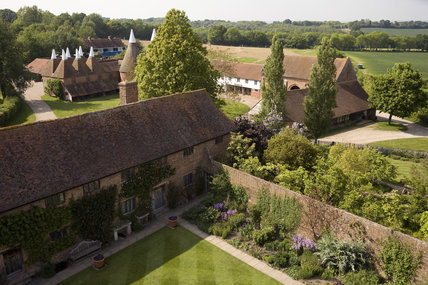 View from the Tower at Sissinghurst Castle Garden over the main range of the house and the oasthouses and restaurant