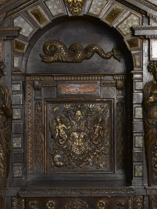 Close view of part of the French cabinet in carved and partly gilded walnut, dating from around 1580, in the Withdrawing Chamber at Hardwick Hall, Derbyshire