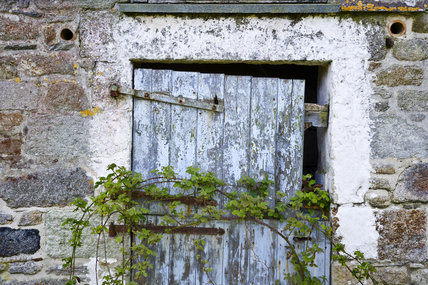 Dilapidated door on old farm building at Godolphin House, near Helston, Cornwall