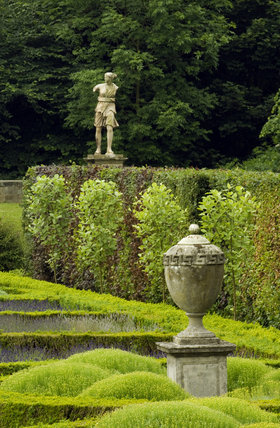 Ornamental urn and statue in the Parterre Garden at Seaton Delaval Hall, Northumberland