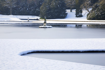 Snow over the Half-Moon Pond at Studley Royal Water Garden, North Yorkshire