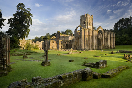 A view towards the east end of the Abbey church showing the great east window arch at Fountains Abbey, North Yorkshire