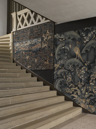 Tapestries, recently conserved, on the stairway on the Upper Landing at Hardwick Hall, Derbyshire