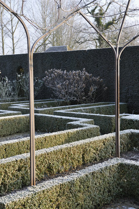 Frost on the box hedging in the White Garden in January at Sissinghurst Castle Garden, near Cranbrook, Kent