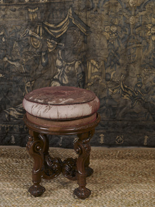 A giltwood stool, c.1685, part of a set of furniture made about 1700 for the Queen of Scots' apartment at Chatsworth, in the Gallery at Hardwick Hall, Derbyshire.
