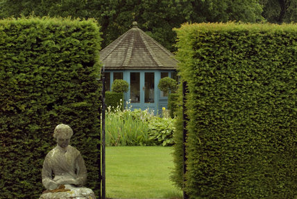 Summer house and statue in the gardens at Seaton Delaval Hall,Northumberland, designed in 1947 by James Rusell with further enhancements by Lady Hastings