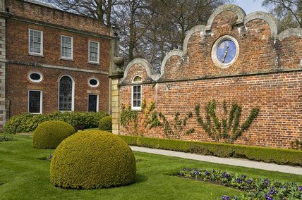 The cusped gable wall with clock brought from Stansty Park, and the Victorian Parterre at Erddig, Wrexham, Wales