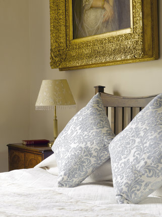 Close view of the pillows and bed in one of the bedrooms of The Apartment at Greenway, Devon, which was the holiday home of the crime writer Agatha Christie between 1938 and 1976