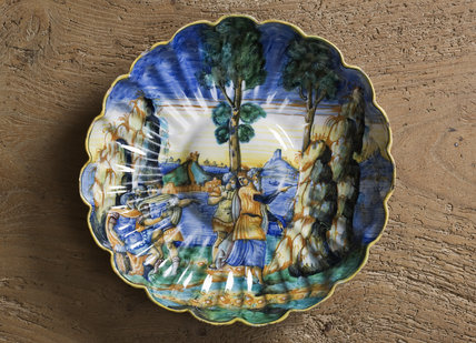 Sixteenth century maiolica dish depicting Moses striking the rock, in the Crimson Bedroom at Montacute House, Somerset