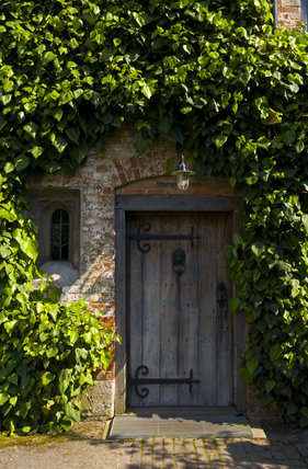 The wooden entrance door in the Courtyard at Baddesley Clinton, Warwickshire