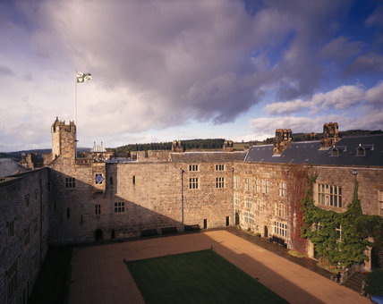 View of the early 14th century west wall of the Courtyard at Chirk Castle, showing the clock house of 1609 projecting on corbels from the inner face of Adam's Tower