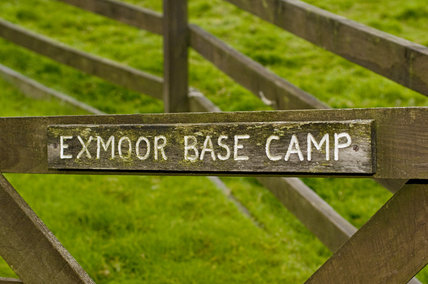 Wooden sign on gate for the Exmoor Basecamp at Countisbury, near Lynmouth, North Devon