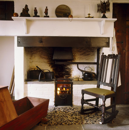 A view of the hearth with the rocking chair at the cottage where George Stephenson was born in 1781