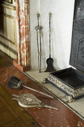 Close view of the silver bellows and ash pan with the Lauderdales' cipher and coronet on the mounts, in the Queen's Bedchamber, Ham House, Richmond-upon-Thames