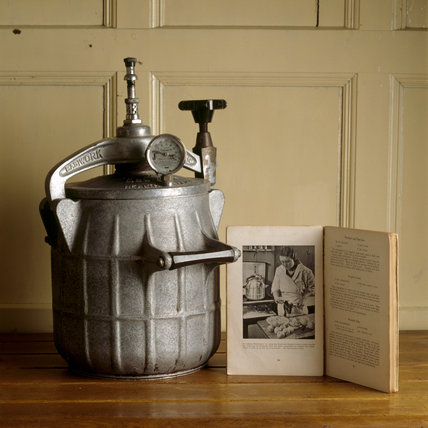 Close up of a pressure cooker with instruction book in the kitchen at Baddesley Clinton