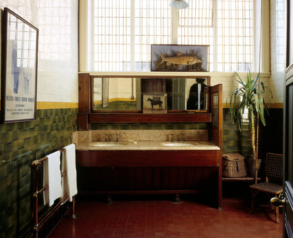 The Gentlemen's Cloakroom at Wightwick Manor, looking towards the tip-up porcelian washbasins set in a marble slab