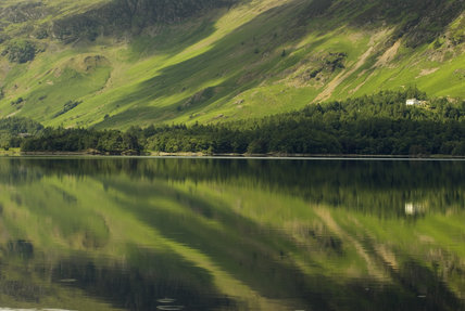 The slopes of Catbells reflected in the lake of Derwentwater, Cumbria