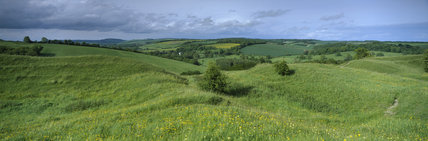 Panoramic view from Hod Hill, an Iron Age hill fort near Blandford, Dorset in summer