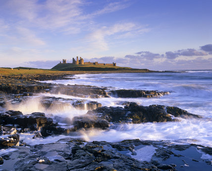 Hauntingly lovely coastline at Craster looking towards Dunstanburgh Castle, Northumberland