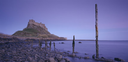 View of the rocky crag and causeway below Lindisfarne Castle at low tide