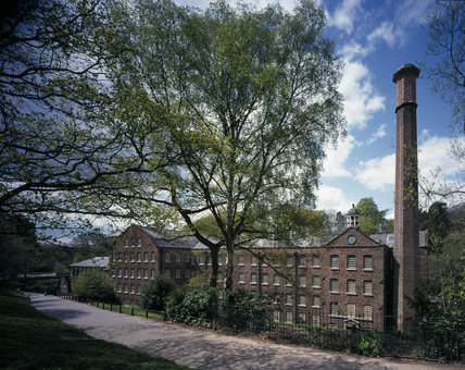 Front elevation of Quarry Bank Mill, a Georgian water-powered cotton mill, showing the chimney & bell tower