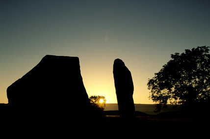 Avebury: Standing stones with buildings behind