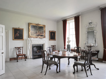 The Dining Room at Melford Hall, Long Melford, Suffolk, showing the pier glass, walnut dining chairs and fireplace