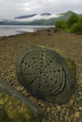 The Centenary Stone at Calf Close Bay, Derwentwater, on a misty morning, Cumbria