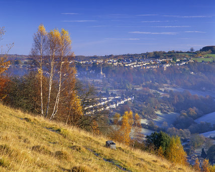 The houses of Stroud visible under a clearing mist from Rodborough Common, in Gloucestershire