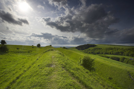 Stormy skies over Blackmore Vale from the Iron-Age hill fort at Hod Hill (National Trust) near Blandford, Dorset