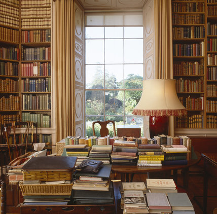 Tables with piles of books in Lady Londonderry's Sitting Room looking towards the window