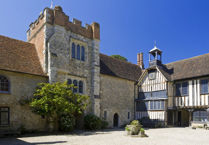 The Gatehouse Tower to the left and the clock to the right, taken from the Courtyard at Ightham Mote, Sevenoaks, Kent, a fourteenth-century moated manor house