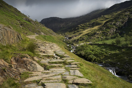 The Watkin Path rising up to Cwm Llan, with Clogwyn Brith to the left, on Hafod Y Llan farm, Snowdonia, Wales