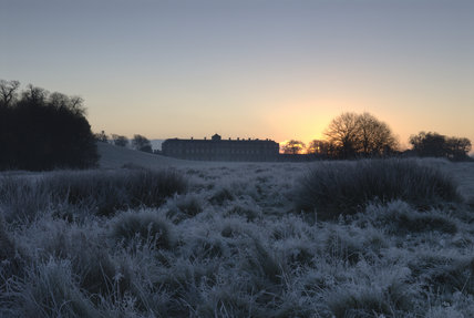 A view over the frosted ground of the parkland towards the house at Petworth, West Sussex